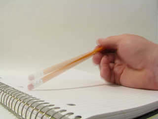 Tapping a pencil by Rennett Snowe